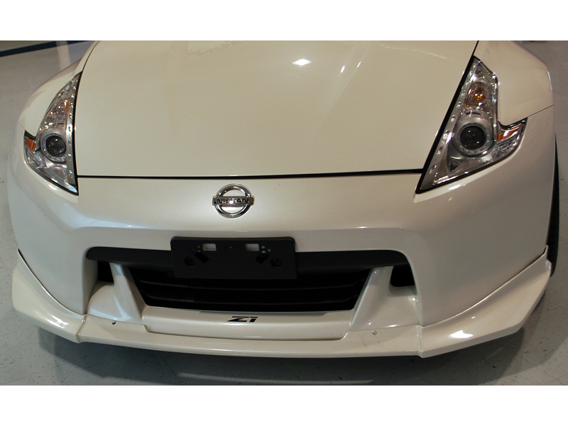 New OEM Nissan Front License Plate Bracket for all u002709+ 370Z (excludes NISMO Edition).  sc 1 st  Z1 Motorsports & OEM License Plate Bracket Z1 Motorsports